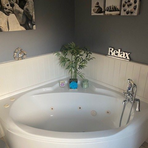 Corner jacuzzi bath freshly scrubbed in Bathgate